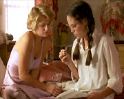Annabeth Gish's character shows aunt Ellen Barkin her emergency identification dog tag in the 1950-set DESERT BLOOM